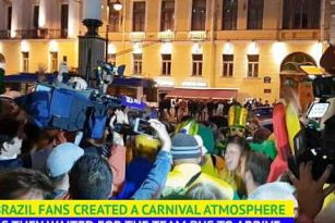 Brazil fans in high spirits as team arrive at hotel