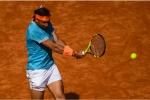 Nadal fights back to halt Mayer in Barcelona