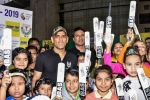 Sporting 'Balidaan Badge' MS Dhoni celebrates Children's Day with students in Ranchi