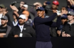 Woods-Manning prevail in star-studded match, raised $20m for charity