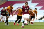 Burnley 1-1 Wolves: Last-gasp Wood penalty dents Nuno's Champions League hopes