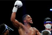 Joshua stops brave Pulev to clear path for Fury fight