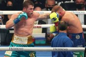 Canelo unifies titles after Saunders' corner waves off fight in front of record crowd