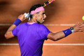 Nadal follows Djokovic into Rome quarters after epic fightback