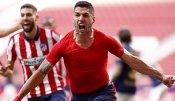 Suarez late-winner takes Atletico Madrid close to La Liga title