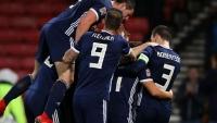 Forrest hat-trick seals Scotland win