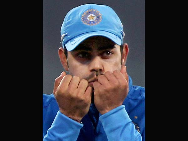 Kohli warms his cold hands