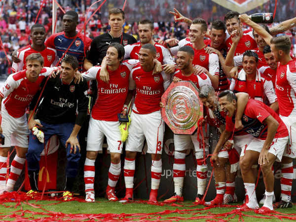 Arsenal's celebrate their win against Manchester City with the trophy at the end of their English Community Shield match