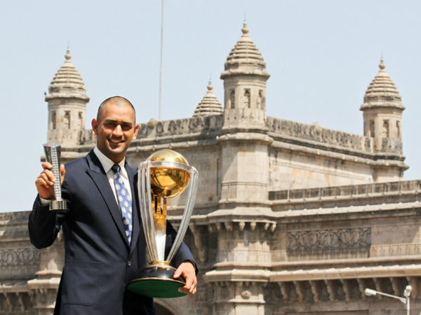 Dhoni with 2011 World Cup trophy and his Man-of-the-final award