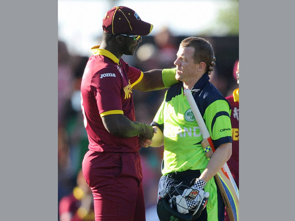 Ireland's Niall O'Brien (right) shakes hands with West Indies' Darren Sammy at the end of their World Cup match