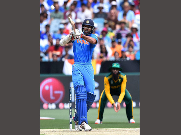 Shikhar plays a shot on way to 137