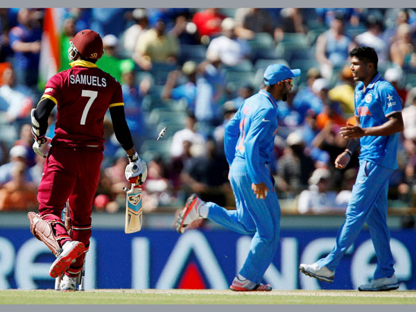 Samuels (left) is run out by Kohli (centre). Also seen is Umesh Yadav