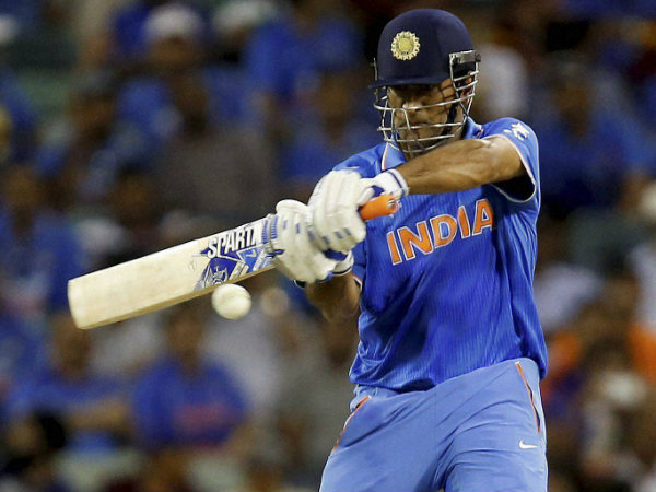 Dhoni plays a shot against West Indies yesterday