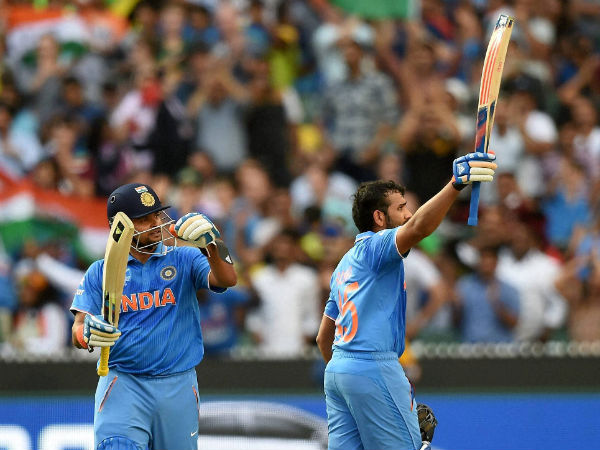 Man of the match Rohit Sharma (right) celebrates after scoring a century while batting against Bangladesh in World Cup 2015