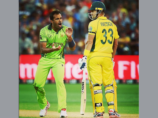 Shane Watson (right) in action against Pakistan in World Cup 2015