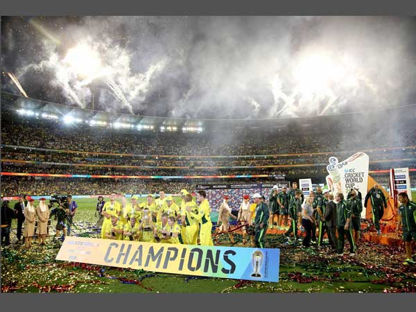 Australian players celebrate in front of the dais
