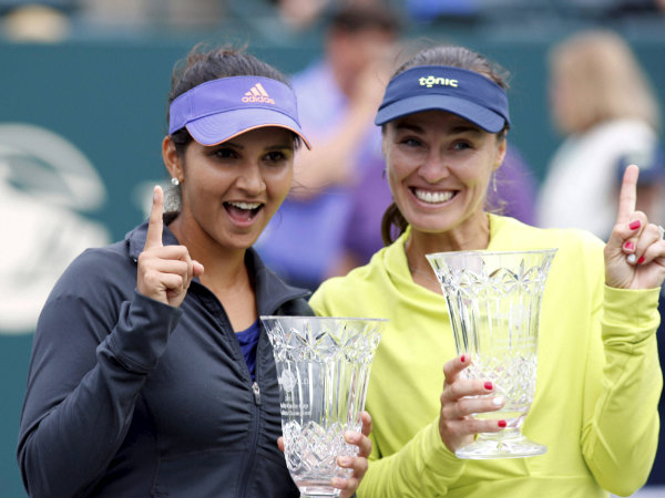 Sania Mirza (left) and her teammate Martina Hingis with their WTA Family Circle title