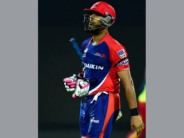 Yuvraj Singh returns to the pavilion after being dismissed for just 2 runs against RCB