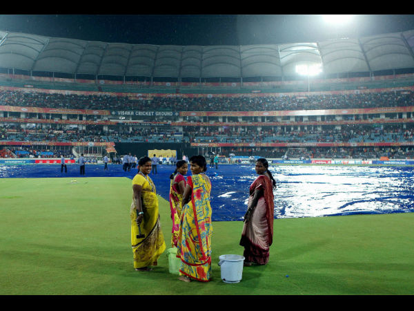 Hyderabad's Rajiv Gandhi International Stadium is covered due to rain during IPL 2015 match between RCB and SRH