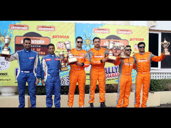 Gaurav Gill (3rd left) and co-driver Musa Sherif (4th left) flanked by second placed Arjun Rao Aroor (extreme left) and Sathish Rajagopal, and third placed Amittrajit Ghosh and Ashwin Naik (right).