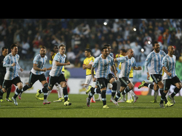 File photo: Argentina's players celebrate after Carlos Tevez scored the winning penalty kick during a Copa America quarterfinal soccer match against Colombia