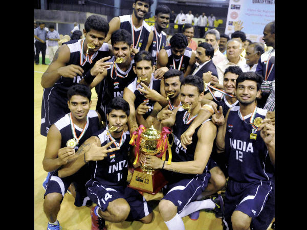 Indian basketball players celebrate after defeating Sri Lanka in final of the 4th South Asian Basketball championship in Bengaluru on Sunday.