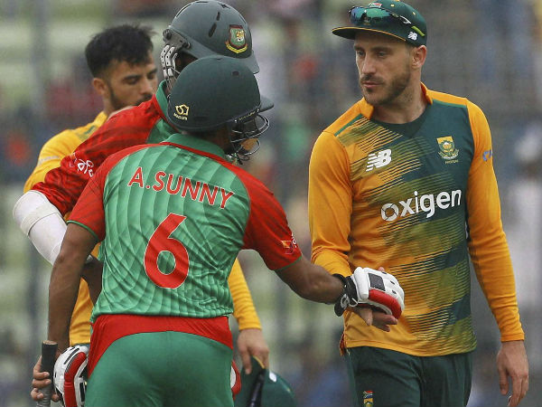 South Africa's captain Faf du Plessis, right, shakes hand with Bangladesh's Arafat Sunny, back to camera, after winning their first T20I