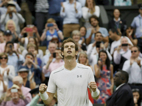 Andy Murray of Britain gestures after defeating Vasek Pospisil of Canada
