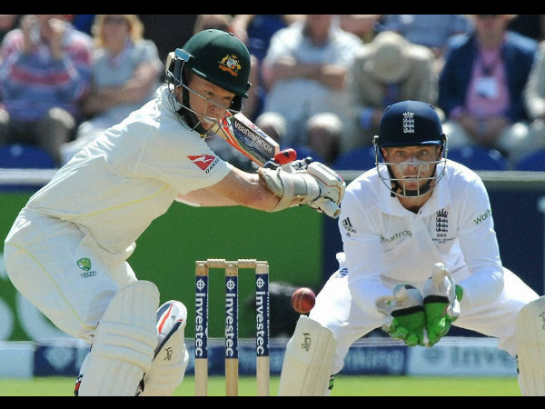 Chris Rogers, left, watched by Jos Buttler as he plays a shot during day two of the first Ashes Test