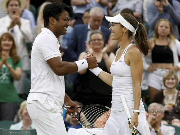 Paes (left) and Hingis celebrate after winning the trophy