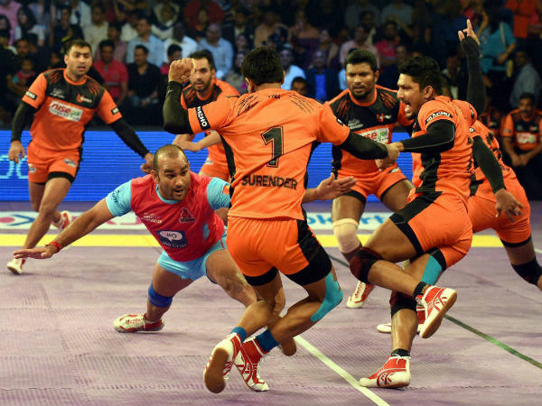 Players in action during a Pro Kabaddi League match between Jaipur Pink Panther and U Mumbai in Mumbai on Saturday.
