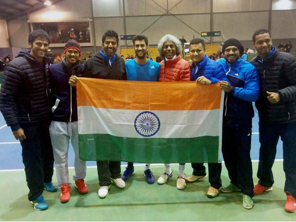 Indian players pose with the Tri-colour after the win
