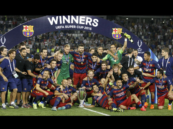 Barcelona Players Celebrate With The Trophy After Winning UEFA Super Cup