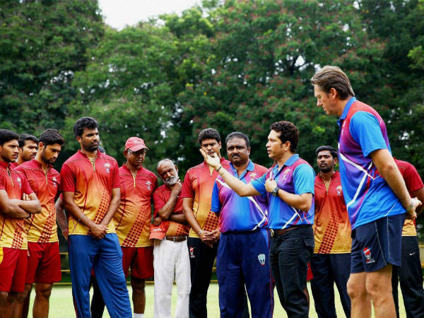 Legends Sachin Tendulkar (3rd from right) and Glenn McGrath (right) interacting with young cricketers at MRF Pace Foundation in Chennai on Friday.