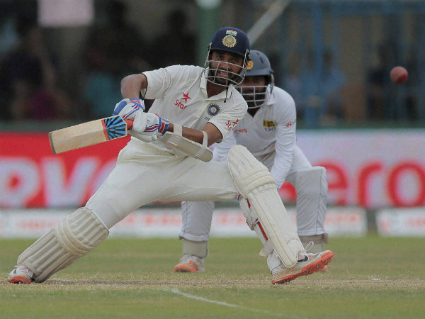 Rahane plays a shot on way to his century