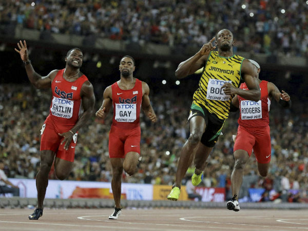 Usain Bolt reacts after winning the men's 100m final at the World Athletics Championships at the Bird's Nest stadium in Beijing on Sunday