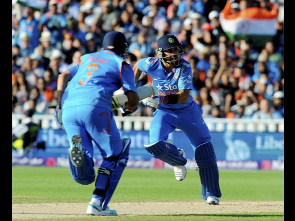 Kohli (right) or Raina - Who will reach there first?