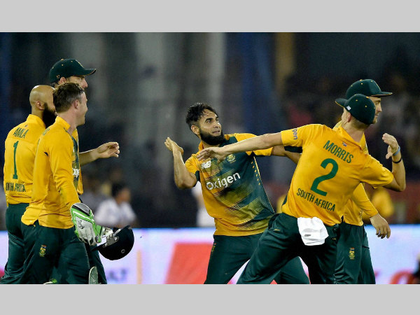 Imran Tahir (centre) celebrates with his team-mates after taking a wicket