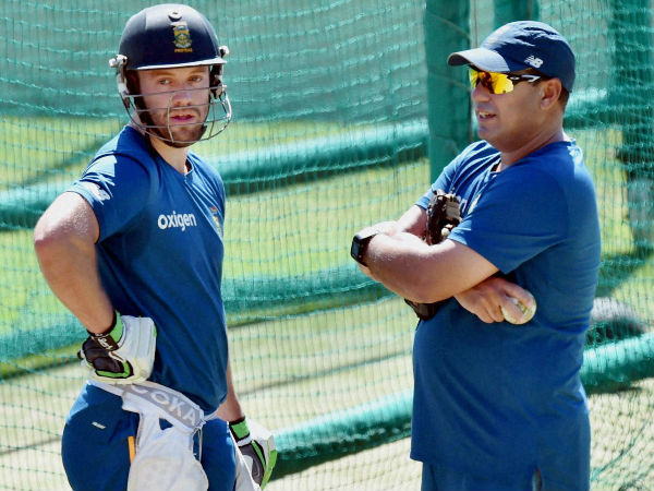 AB de Villiers (left) with team coach Russell Domingo during a training session