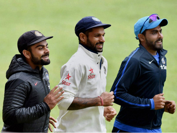 Kohli (left), Dhawan (centre) and Ravindra Jadeja run during a training session in Bengaluru