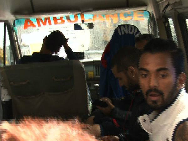 KL Rahul (right) is seated in the ambulance
