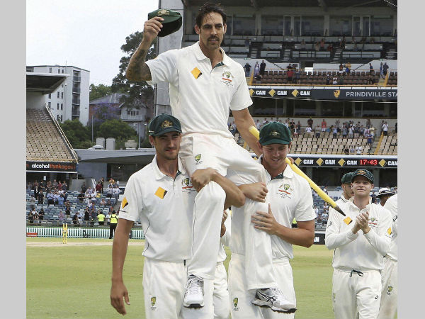 Mitchell Johnson is chaired off the ground by team-mates Mitchell Starc (left) and Josh Hazlewood after completing in his final test in the cricket test match against New Zealand in Perth, Australia, Tuesday, November 17