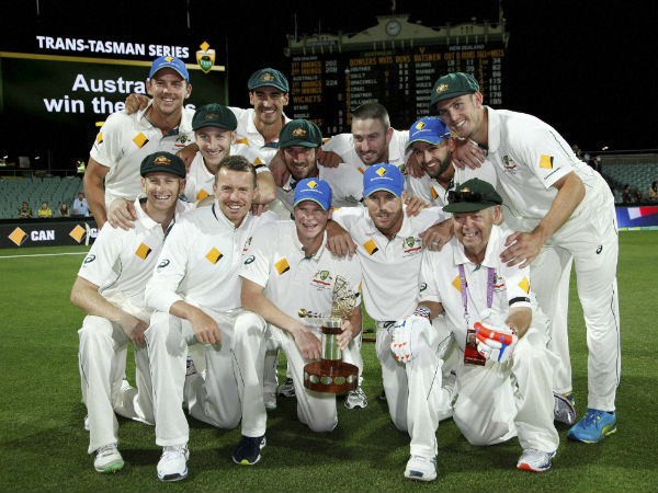 Australian players pose with the trophy after winning the day-night Test and the series 2-0 over New Zealand