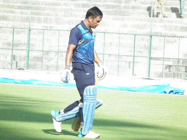 Dhoni walks back to the pavilion after scoring 18. Photo by Aprameya .C