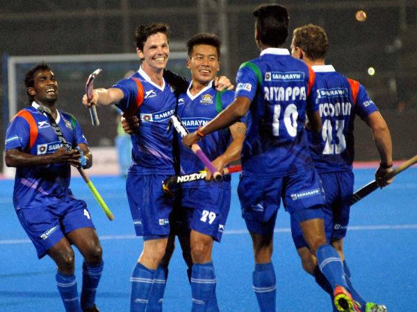 UP Wizards players celebrate a goal against Kalinga Lancers