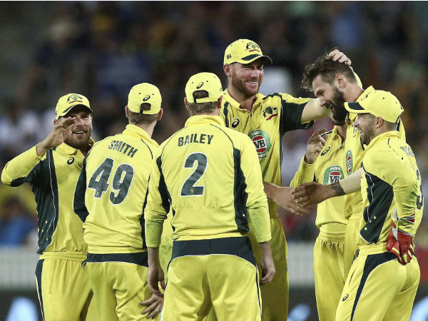 Australian players celebrate a wicket in Canberra