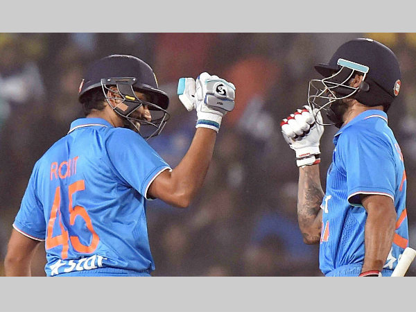 Rohit (left) and Shikhar react after their 50-run partnership