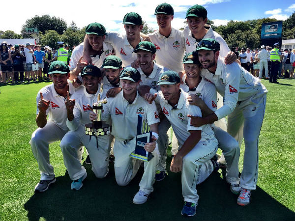 Australian players pose with the trophy after series win