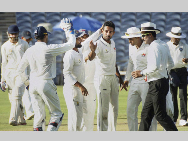 Dhawal Kulkarni (4th from right) and his team-mates celebrate a wicket in Ranji Trophy final