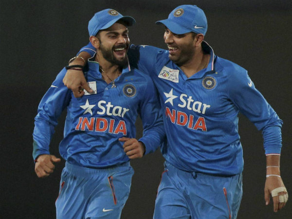Virat Kohli (left) and Yuvraj Singh are ecstatic after Khurram Manzoor's dismissal